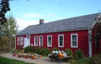 Red Building with pumpkins and gourds in front